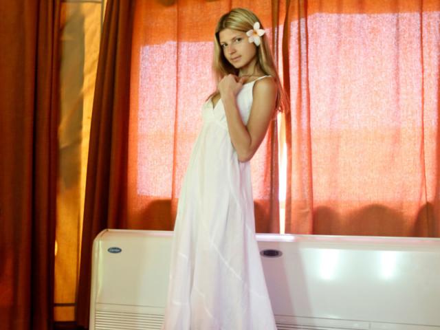 Blonde Girlfriend poses in suite room