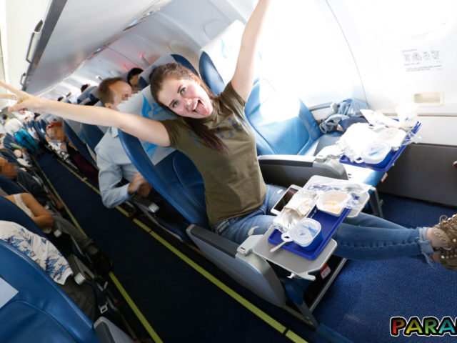 Horny Girlfriend stretches out to show off for other passengers on airplane