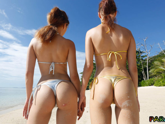 Tiny thong in their twin cracks on the beach