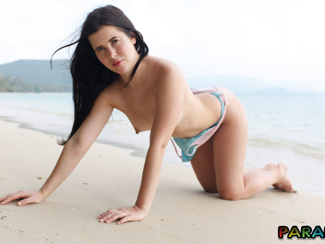 Pointy hard nipples on beach in topless Holiday photo