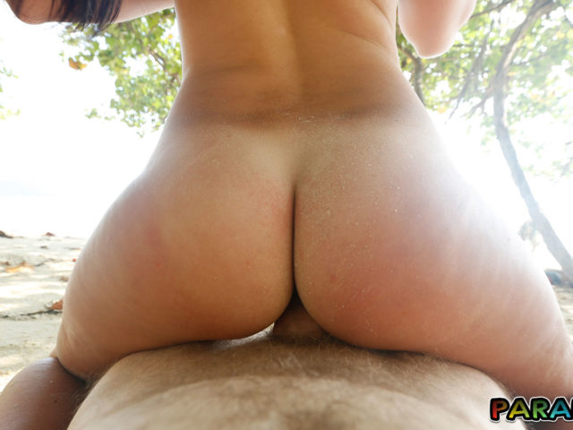 Naked Holiday sex outdoors behind tree on beach