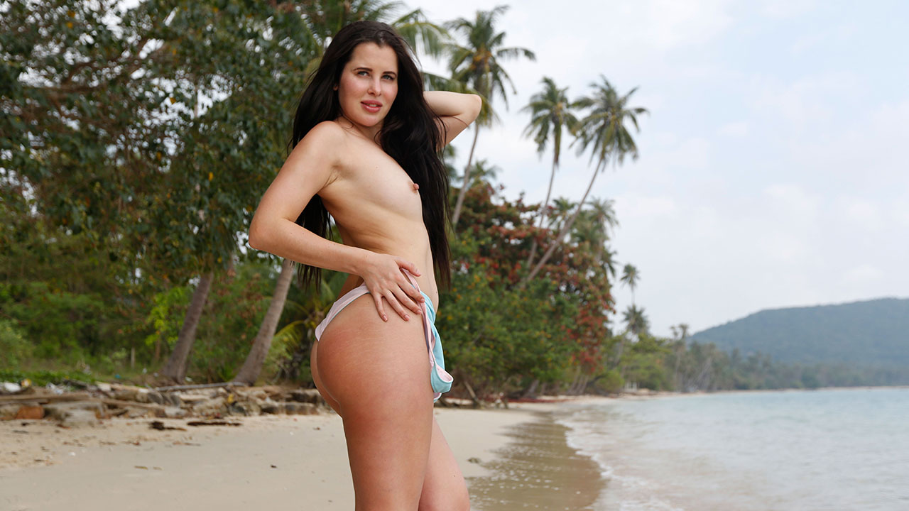 Brunette Cassie Fire Stripping On Beach